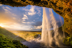 Seljalandsfoss (BenjaminMWilliamson) Tags: attraction backlighting cave clouds composition gifts glow iceland image landscape light mist prints ringroad scenery scenic seljalandsfoss spray sunset tourism tourist travel vik water waterfall