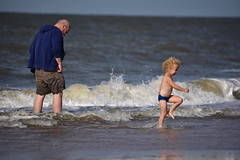 Those who want to get wet need no umbrella!  :) (Pics4life.nl off and on next week) Tags: beach strand kid pepole water nature sky waves shore colors colorful blue scheveningen nederland holland