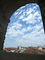 Arles Amphitheatre (AmyEAnderson) Tags: coliseum amphitheatre stadium historic roman romanesque arch clouds rooftops arles france bouchesdurhone provence contrast contrasts