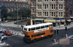 A big orange crosses Deansgate (Museum of Transport Greater Manchester archive) Tags: museum transport cheetham manchester wwwgmtscouk gmts bus buses museumoftransport gmtscollection greatermanchestertransportsociety boylestreet cheethamhill m88uw greatermanchester greatermanchestertransport leyland atlantean northerncounties ncme rear above cathedral deansgate stmarysgate cannonstreet cannonst gmt gmpte standard mynshull house ford escort volkswagen