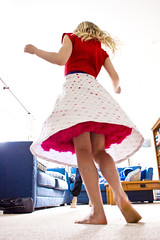 Showing off the Party Dress 4 (C & R Driver-Burgess) Tags: spin flare flair skirt polka dot red tulle petticoat slip bodice blonde hair whirl twist twirl child girl boy kids hikey over exposed blue couch settee inside lounge
