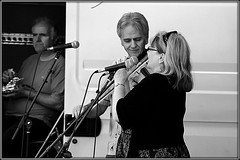 Folk in the park (* RICHARD M) Tags: street blackandwhite musician mono candid duo microphones performance smiles musicmakers mikes entertainment violin singer fiddle performers folkmusic violinist southport fiddler merseyside showbiz troubadours sefton entertainers folkinthepark heskethpark