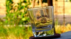 Empty JD Flask Fighting For More Whiskey (Jangra Works) Tags: glass jack daniels greenery splash jd edit kumars