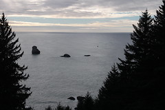 A boat comes by to check out House Rock (rozoneill) Tags: ranch park beach oregon island coast state hiking trail lone boardman samuel brookings whaleshead wsweekly112