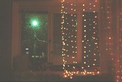 indoor/outdoor magic (son harry) Tags: christmas light snow film window analog 35mm darkness bokeh miracle magic sparks sparkling
