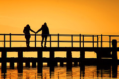 love / lake / sunset (marcosmallred) Tags: italien sunset people italy color colors silhouette lago italia tramonto silhouettes italie umbria trasimeno pontile umbrien torricella