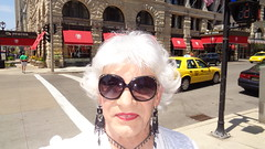 H'mm; I Wonder Where I Should Spend This Sunday Afternoon In Milwaukee :) (Laurette Victoria) Tags: woman sunglasses silver necklace downtown sidewalk milwaukee earrings pfisterhotel laurette