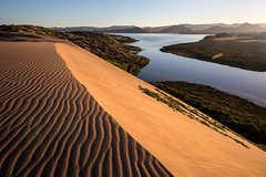 Separate Worlds (Kevin Dinkel) Tags: california morning travel sea water sunrise landscape flow photography bay early sand kevin waves shadows escape desert dune places crest ripples lush morro dinkel
