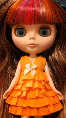 My first Blythe! She's factory and I love her! Her name is Pumpkin. The only thing is her head is tilted way down. Is there any way to fix that?