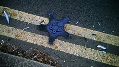 star of wonder (dr_loplop) Tags: road broken leaves lines car wheel tarmac yellow star wire pavement double east plastic dried shattered kerb hubcap butisitart nocathere nowmoveon whentheysawthestartheyrejoicedwithexceedinggreatjoy