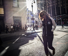 New York Yankees (stejo) Tags: street sun newyork photo flare madisonsquaregarden earphones gatufoto