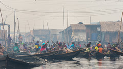Makoko Rush Hour (Warriorwriter) Tags: poverty life africa people house water trash river living smog dangerous community families culture lagos safety crime pollution nigeria shanty disease slum congestion pirogue crowded dugoutcanoe disparity westernafrica makoko