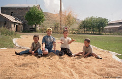 Happy childhood. (Hayk Senekerimyan) Tags: autumn trees sky mountains film smile grass lines clouds canon children happy sand village wind country harvest sigma happiness roofs armenia laugh electricity column dust gruond