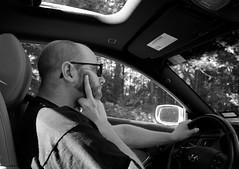(heatherbirdtx) Tags: portrait blackandwhite sunlight man male bird window car driving availablelight finger off story flip editorial driver middle gesture profane