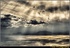 ... - Sunrays everywhere... (Nick Papakonstantinou) Tags: blue winter sea sky sun mountain weather clouds reflections grey nikon greece sunrays hdr pelion chania volos heavyweather thessaly heavyclouds hdrphotography magnesia pagaseticgulf d3100 nikond3100