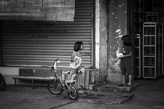 Childhood (-clicking-) Tags: life bw monochrome childhood children blackwhite child streetphotography streetlife monotone vietnam childlike