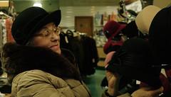 Minsk (Natali Antonovich) Tags: winter portrait hat shop glasses mood hats selection stare belarus minsk motherlandbelarus hatisalwaysfashionable
