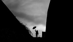 The Boy Who... (iratebadger) Tags: boy bw black monochrome silhouette umbrella 35mm fun blackwhite nikon child nikkor f18 d7100 nikond7100 iratebadger
