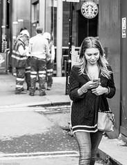 hmm interesting (Wayne Stiller) Tags: people woman white black men london lady walking interesting workers construction text hi vis tonal
