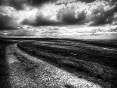 Blackstone Edge (Missy Jussy) Tags: england sky bw monochrome clouds canon landscape outside mono blackwhite moody wind outdoor path atmosphere lancashire hills land moors rochdale moodylandscape blackstoneedge walkinglandscape canonpowershotsx60