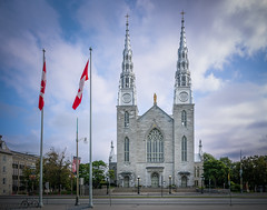 Notre Dame Cathedral Basilica of Ottawa (-> LorenzMao <-) Tags: blue red canada tower church clouds lens cathedral cloudy basilica flag ottawa bluesky flags canadianflag notredamecathedral sigmalens notredamecathedralbasilica flagofcanada 2tower 1750lens notredamecathedralbasilicaofottawa sigma1750lens