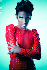 karla in red. (Alli Jiang) Tags: red portrait people woman girl fashion female pose photography photo model eyes colorful dress fierce fashionphotography makeup posing stare shorthair femalemodel staring eyemakeup shinydress shinyclothing fiercelook allijiang redandcyan longsleevedress allijiangphotography karlacheers