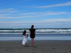 Immobile Motion (e.mmacook) Tags: ocean blue girls sea sky cloud white black beach hair twins sand waves dress skin wind grain breeze blown