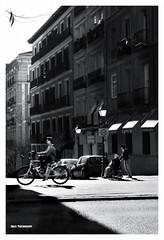 (Imati) Tags: madrid leica contraluz calle chica bicicleta anciana da hombre silladeruedas