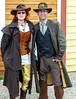 Steampunk Couple (J Wells S) Tags: ohio female costume dressup tights williamsburg corset gears youngwoman candidportrait greatcoat oldwestfestival steampunkcouple 2014steampunkday