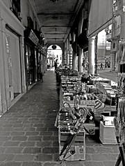 """Street Market"" (giannipaoloziliani) Tags: street city blackandwhite italy monochrome market arcade citylife streetphotography mantova shops streetphoto lombardia mantua streetmarket urbanstreet giannipaoloziliani"