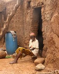 burkina faso - old lobi woman with two plugs in sansana village (Retlaw Snellac Photography) Tags: africa woman tribal tribe burkinafaso lobi