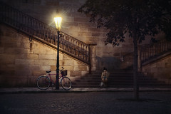 waiting... (cherryspicks (intermittently on/off)) Tags: girl bicycle bike waiting night dark mood atmosphere light lamppost lamp street person people