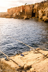Fishing at Boca do Inferno (ManuelHurtado) Tags: ocean travel sunset sea summer sky cliff lighthouse seascape portugal nature water rock stone relax landscape golden evening bay coast seaside fishing natural outdoor dusk cove sightseeing places hobby atlantic erosion countries coastal shore maritime rod leisure relaxation geological