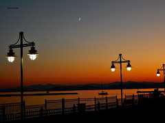 DSCN0091-2 (moon_hunter2014) Tags: sunset sun moon mountains colors burlington sunrise lights pier boat vermont waterfront crescent boardwalk phase