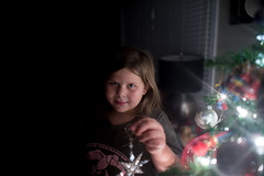 Decorating The Christmas Tree (Mark Wingfield) Tags: christmas tree girl night dark lights star eyes lowlight nikon low 14 iso indoors ornaments decorating 24mm d610