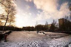 desolate playground (bjdewagenaar) Tags: park trees urban sun snow playground clouds raw angle sony wide sigma alpha 1020mm lightroom a58 10mm