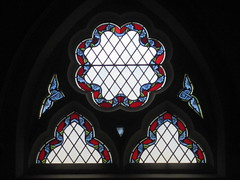 A Quarry Glass Stained Glass Lunette Above the Sideway Entrance to the St Kilda Presbyterian Church - Corner Barkley Street and Alma Road, St Kilda (raaen99) Tags: blue red flower building green window glass floral architecture religious suburban religion gothic victorian australia melbourne stainedglass victoria victoriana suburbs 1886 stainedglasswindow stkilda presbyterian nineteenthcentury tracery leadlight gothicarchitecture placeofworship 1880s gothicchurch gothicbuilding presbyterianchurch gothicstyle almaroad ralphwilson melbournearchitecture gothicrevivalarchitecture religiousbuilding gothicrevivalstyle victorianstainedglass melbournesuburbs almard leadlightglass barkleyst gothicrevivalbuilding barkleystreet stkildachurch architecturallydesigned fergusonurie gothicrevivalchurch boomperiod stkildapresbyterianchurch fergusonandurie johnbeswicke gothicdetail fergusonanduriestainedglass fergusonuriestainedglass quarryglass wilsonandbeswicke presbyterianchurchofstkilda wilsonbeswicke