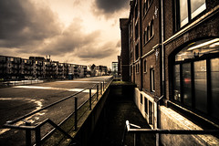 nice neighborhood (bjdewagenaar) Tags: old city light sky urban colors architecture clouds century contrast buildings rotterdam raw angle sony wide perspective sigma warehouse alpha 1020mm lightroom a58 10mm