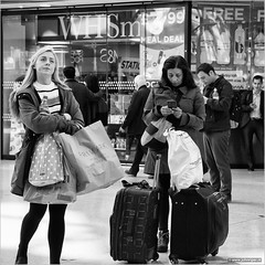 Daydream (John Riper) Tags: street uk ladies girls england people bw white black monochrome smart liverpool canon john square photography mono waiting phone zwartwit candid luggage blond l bags baggage limestreet ringing whsmith daydreaming 6d limestreetstation primark 24105 straatfotografie riper johnriper daudream