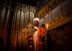 Ethiopian orthodox priest holding a cross inside a rock church, Amhara region, Lalibela, Ethiopia (Eric Lafforgue) Tags: africa travel man color men horizontal outdoors worship candle cross adult african faith religion unescoworldheritagesite celebration holy indoors sacred priest christianity shawl spirituality ethiopia orthodox religiouscelebration oneperson candlelit traditionalculture lalibela hornofafrica ethiopian eastafrica thiopien etiopia abyssinia ethiopie traditionalclothing etiopa onlymen onemanonly onematuremanonly  etiopija 1people ethiopi  africanculture etiopien etipia  etiyopya  amhararegion         semienwollozone ethio163622