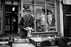 Get Your Five-a-Day (nigelhunter) Tags: street old urban man vegetables glasses day flat market 5 five candid cap spectacles bloke pensioner