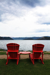 Red-irondack (Christie Purchase) Tags: red sky water contrast newfoundland nationalpark chair vibrant pair calm serene adirondack grosmorne gros adirondackchair morne