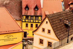 Togetherness (Tanya.Kirilova) Tags: roof urban yellow architecture composition town europe cityscape medieval roofs czechrepublic lantern ochre oldhouses loket halftimbered urbanphotography urbantexture halftimberedhouse nikond7100