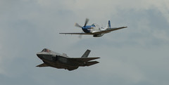 F-35A Lightning ll and P-51D Mustang (vsturgess) Tags: fly past f35a lightning ll p51d mustang 56th fighter wing usvair force luke afb aircraft airshow usa us 300mm 400d 400mm 500mm fastjet fairford fast canon north america