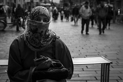 Window To The Soul (Leanne Boulton) Tags: life street city uk light shadow portrait people urban blackandwhite bw woman white black detail texture girl monochrome face female canon 50mm mono scotland living blackwhite eyes natural emotion humanity bokeh outdoor expression glasgow candid muslim faith religion hijab culture thoughtful streetphotography belief streetlife scene depthoffield human shade portraiture 7d feeling niqab society tone candidportrait candidstreetphotography
