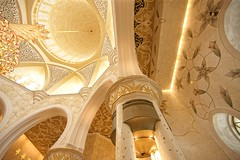 ABU DHABI, UAE - MAY 13, 2014: Sheikh Zayed Mosque in Abu Dhabi, considered to be the key for worship in the United Arab Emirates (Stan de Haas Photography) Tags: wall interior uae islam decoration tower arch white dhabi mosque pillars marble landmark culture zayed cupola arabesque grand sheikh spiritual hall chandelier minaret united dome building religious place swarovski room arabian design architecture temple emirates abu masjid holy abudhabi religion islamic art arab monument prayer muslim standehaas