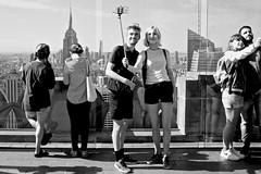 Top Of The Rock Selfie People 1 (andyfpp) Tags: fuji fujifilm x100t newyork nyc newyorkcity blackandwhite bw bwred mono monochrome monotone selfie stick iphone rock topoftherock shadows rockefeller
