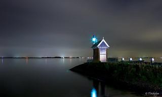 The Volendam harbor at night