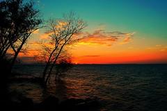 lake of fire (emanuele fer) Tags: light italy lake nature night clouds landscape lago italia nuvole natura cielo luce paesaggio umbria onda