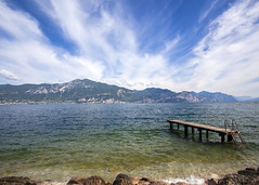 Jetty at Torri del Benaco (Hans van der Boom) Tags: vacation italy lake holiday clouds pier garda italia jetty it gardameer itali lakegarda veneto torridelbenaco lakescape venetoverona